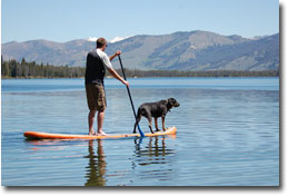 Luc and Aspen enjoying a ride on a Big Earl SUP Board on Redfish Lake, Idaho