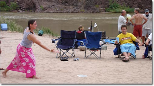Amy making a Cans toss on a Grand Canyon beach.