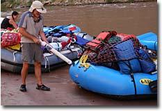 Arthur adjusting boat pressure on a July Grand Canyon trip.