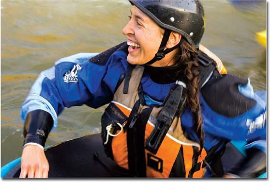 Smiling kayaker wearing a helmet