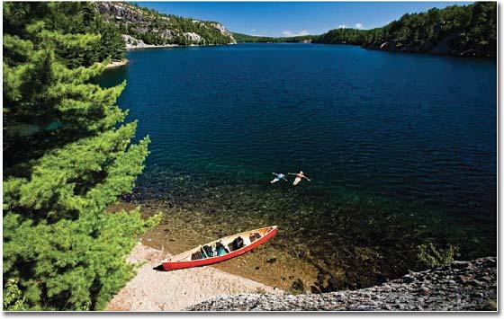 empty canoe on the shore of a lake