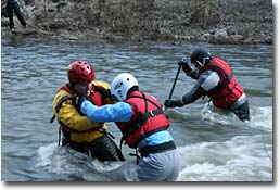 practicing swiftwater rescue techniques